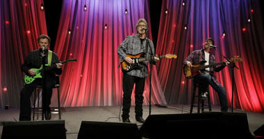 Jeff Cook, left, Randy Owen, center, and Teddy Gentry of the group Alabama tapes a song for Dolly Parton's Smoky Mountain Rise Telethon in Nashville, Tenn.