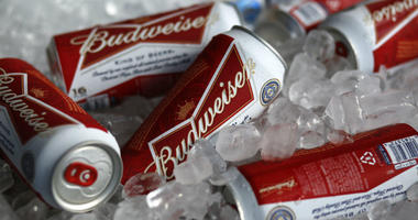 In this March 5, 2015, file photo, Budweiser beer cans are on ice at a concession stand at McKechnie Field in Bradenton, Fla.