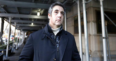 FILE - In this Dec. 7, 2018 file photo, Michael Cohen, former lawyer to President Donald Trump, leaves his apartment building in New York.