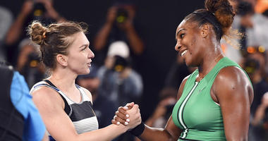 United States' Serena Williams, right, is congratulated by Romania's Simona Halep after winning their fourth round match at the Australian Open tennis championships in Melbourne, Australia, Monday, Jan. 21, 2019.