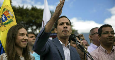 Venezuela's self-declared interim leader Juan Guaido, accompanied by his wife Fabiana Rosales, speaks to supporters during a gathering to propose amnesty laws for police and military, at a public plaza in Las Mercedes neighborhood of Caracas, Venezuela, S