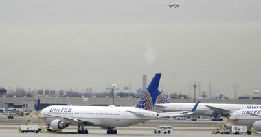 FILE - In this Wednesday, Jan. 23, 2019 file photo, United Airlines jets are seen as a plane approaches Newark Liberty International Airport, in Newark, N.J.