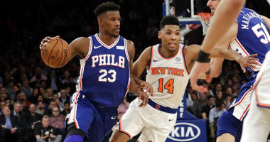 Philadelphia 76ers' Jimmy Butler (23) drives past New York Knicks' Allonzo Trier (14) during the first half of an NBA basketball game, Wednesday, Feb. 13, 2019, in New York.