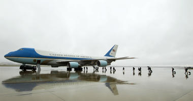 In this April 6, 2017, file photo, members of the White House press corps board Air Force One before the arrival of President Donald Trump at Andrews Air Force Base, Md.