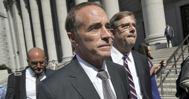 This Aug. 8, 2018 file photo shows Republican U.S. Rep. Christopher Collins as he leaves federal court in New York. In an about-face, Collins says he will suspend his re-election campaign after insider-trading indictment.