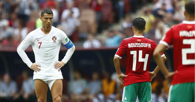 Portugal's Cristiano Ronaldo, left, prepares to shot a free kick during the group B match between Portugal and Morocco at the 2018 soccer World Cup in the Luzhniki Stadium in Moscow, Russia, Wednesday, June 20, 2018.