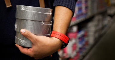 A man shops for duct tape at Home Depot.