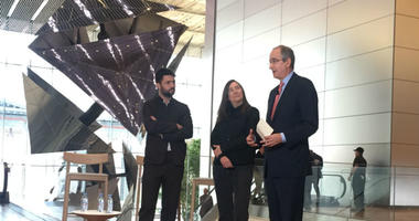 From left: Artists Conrad Shawcross and Jenny Holzer speak with Comcast CEO Brian Roberts.