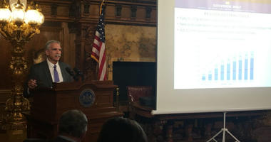 Albright briefs reporters in the state Capitol Tuesday