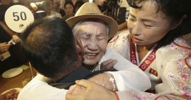 South Korean Lee Keum-seom, 92, center, hugs her North Korean son Ri Sang Chol, 71, left, during the Separated Family Reunion Meeting at the Diamond Mountain resort in North Korea, Monday, Aug. 20, 2018.