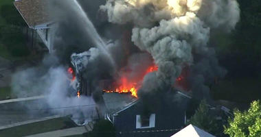 In this image take from video provided by WCVB in Boston, flames consume a home in Lawrence, Mass, a suburb of Boston, Thursday, Sept. 13, 2018.