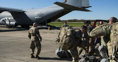 Deployers from Headquarters Company, 89th Military Police Brigade, Task Force Griffin get ready to board a C-130J Super Hercules from Little Rock, Arkansas, at Fort Knox, Kentucky, in support of Operation Faithful Patriot.