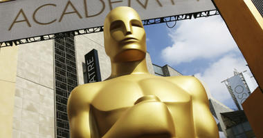 In this Feb. 21, 2015 file photo, an Oscar statue appears outside the Dolby Theatre for the 87th Academy Awards in Los Angeles.