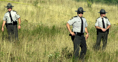 State police stand guard near Stoystown, Pennsylvania, 400 yards from the crash site of the fourth plane hijacked on Tuesday, September 11, 2001.