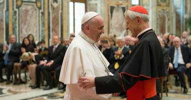 In this April 17, 2015, file photo, Pope Francis, left, talks with Papal Foundation Chairman Cardinal Donald Wuerl, Archbishop of Washington, D.C.