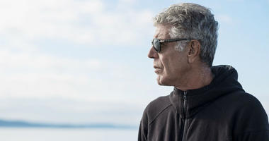 """Anthony Bourdain, a gifted storyteller and writer who took CNN viewers around the world, died at age 61. Bourdain rides the ferry to Vashon Island in July 2017 while filming """"Parts Unknown"""" in Seattle."""