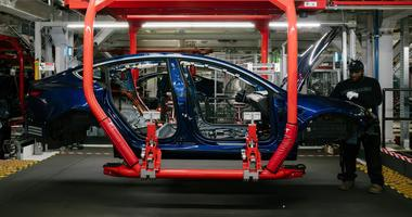 """Tesla CEO Elon Musk said his electric car company came """"within single-digit weeks"""" of death this year as it struggled to meet production targets for its Model 3 sedan."""
