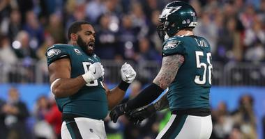 Philadelphia Eagles defensive end Brandon Graham (55) celebrates with Chris Long (56) after causing a fumble against the New England Patriots receiver in the fourth quarter in Super Bowl LII.