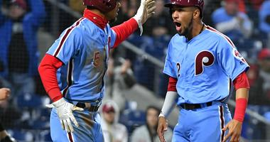 Apr 19, 2018; Philadelphia, PA, USA; Philadelphia Phillies right fielder Nick Williams (5) and Philadelphia Phillies shortstop J.P. Crawford (2) celebrate after scoring during the second inning against the Pittsburgh Pirates at Citizens Bank Park.