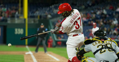 Apr 20, 2018; Philadelphia, PA, USA; Philadelphia Phillies center fielder Odubel Herrera (37) hits a single during the sixth inning against the Pittsburgh Pirates at Citizens Bank Park