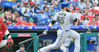 Toronto Blue Jays catcher Russell Martin (55) hits a single during the sixth inning against the Philadelphia Phillies at Citizens Bank Park.