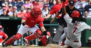 Philadelphia Phillies third baseman Maikel Franco (7) beats the tag attempt by Washington Nationals catcher Spencer Kieboom (64) to score a run during the second inning at Nationals Park.