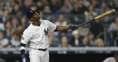 New York Yankees center fielder Andrew McCutchen (26) reacts at bat in the third inning against the Boston Red Sox in game three of the 2018 ALDS playoff baseball series at Yankee Stadium.
