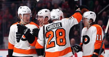 Jan 19, 2019; Montreal, Quebec, CAN; Philadelphia Flyers defenseman Robert Hagg (8) celebrates his goal against Montreal Canadiens with teammates during the second period at Bell Centre.