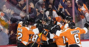Feb 2, 2019; Philadelphia, PA, USA; Philadelphia Flyers center Nolan Patrick (19) is mobbed by team mates in front of cheering fans after scoring the game winning goal against the Edmonton Oilers during overtime at Wells Fargo Center.