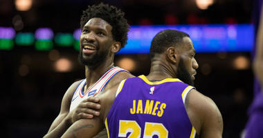 Feb 10, 2019; Philadelphia, PA, USA; Philadelphia 76ers center Joel Embiid (21) reacts with Los Angeles Lakers forward LeBron James (23) after a 76ers score during the fourth quarter at Wells Fargo Center.