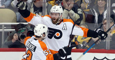 Mar 17, 2019; Pittsburgh, PA, USA; Philadelphia Flyers center Sean Couturier (14) celebrates after scoring the game winning goal with defenseman Shayne Gostisbehere (53) against the Pittsburgh Penguins in overtime at PPG PAINTS Arena. Philadelphia won 2-1