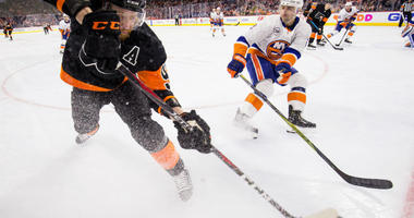 Mar 23, 2019; Philadelphia, PA, USA; Philadelphia Flyers right wing Jakub Voracek (93) passes the puck as New York Islanders defenseman Nick Leddy (2) defends during the first period at Wells Fargo Center.