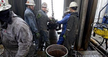 A Seneca Resources Corp. crew prepares a 2009 well-drilling site in Loyalsock State Forest near Trout Run, Pa.