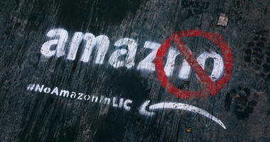 Graffiti has been painted on a sidewalk by someone opposed to the location of an Amazon headquarters in Long Island City in Queens, New York City.