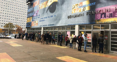 A long line snakes around Benjamin Franklin High School, a polling place in Philadelphia.