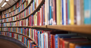 Close up photo of books in a row in Library