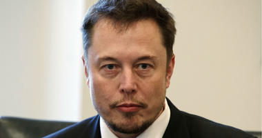In this Dec. 14, 2016, file photo, Tesla CEO Elon Musk listens as President-elect Donald Trump speaks during a meeting with technology industry leaders at Trump Tower in New York.
