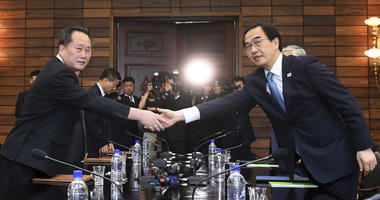 South Korean Unification Minister Cho Myoung-gyon, right, shakes hands with his North Korean counterpart Ri Son Gwon during their meeting at the northern side of Panmunjom in the Demilitarized Zone, North Korea, Monday, Aug. 13, 2018.