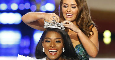 Miss New York Nia Franklin reacts after being named Miss America 2019, as she is crowned by last year's winner Cara Mund, Sunday, Sept. 9, 2018, in Atlantic City, N.J.