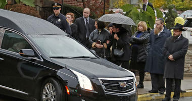 Mourners watch as the hearse carrying the casket of Richard Gottfried leaves the Ralph Schugar Funeral home in Pittsburgh following a memorial service Nov. 1, 2018.