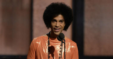 FILE PHOTO; Recording artist Prince presents the award for the album of the year at the 57th Grammy Awards