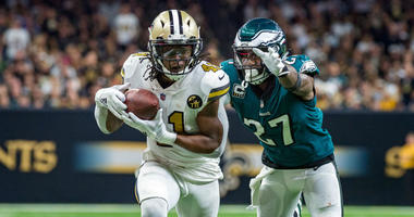 New Orleans Saints running back Alvin Kamara (41) runs the ball against Philadelphia Eagles strong safety Malcolm Jenkins (27) at the Mercedes-Benz Superdome.