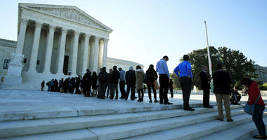 In this Oct. 3, 2017, file photo, people line up outside the U.S. Supreme Court in Washington to hear arguments in a case about political maps in Wisconsin that could affect elections across the country.