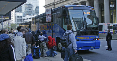 Riders on Megabus gather outside Union Station on the east side of Canal Street in Chicago, Illinois.