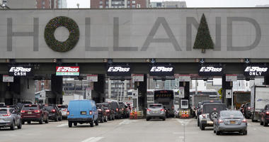 Holiday decorations adorn the letters on the toll booth structure on the Holland Tunnel.