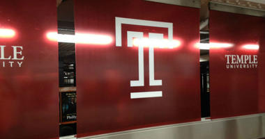 New Temple University signage on the southbound side of Cecil B. Moore station