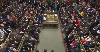 Britain's Prime Minister Theresa May, center left, speaks in the House of Commons, after MPs rejected a no-confidence vote against the government, in London, Wednesday Jan. 16, 2019.