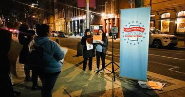 Immigrant advocacy group Make the Road Pennsylvania gathered in front of Sen. Pat Toomey's office Wednesday night to make their voices heard on the president's proposed border wall.