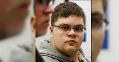 In this March 6, 2017, file photo, Gloucester County High School senior Gavin Grimm, a transgender student, listens to a speaker during a news conference.