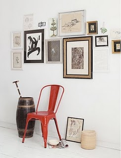 white-walls-and-floors-red-metal-chair
